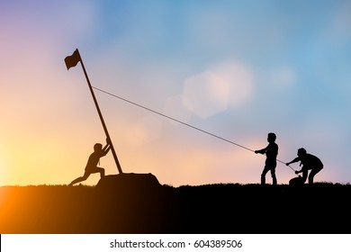 Silhouette team business helps Work together as a team to accomplish your goals to reach the finish line over blurred natural. Motivate employee growth concept.