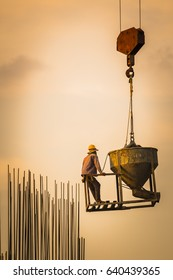 silhouette team of construction building workers work on all construction sites. Construction safety is very important to ensure a safe environment for the workers.