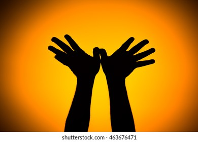 Silhouette of a team of people hands shows gesture ok