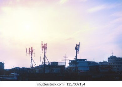 Silhouette telecommunication GSM (5G,4G) post on the building.Digital wireless connection system.Cellular telephone network.Development of communication systems in urban areas.Antenna