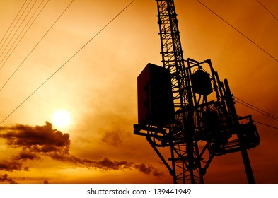 silhouette telecommunication pole with sunrise