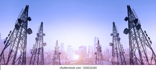 Silhouette, telecommunication towers with TV antennas and satellite dish in sunset, with double exposure city in sunrise background