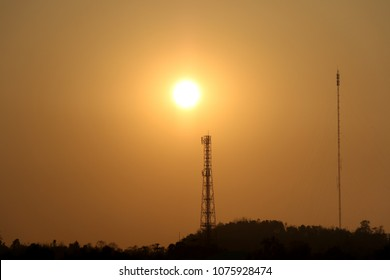 Silhouette of  telecommunications tower for transmitting, beautiful light from the sunset, high pillars and signaling cover all areas