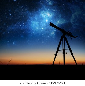 Silhouette of Telescope. Elements of this image furnished by NASA.