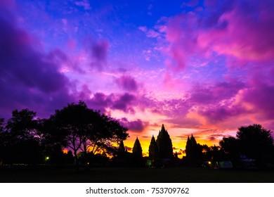 Silhouette of a temple complex against a beautiful red orange purple sky after sunset. Candi Prambanan Hindu Temple, Yogyakarta, Jawa, Indonesia.