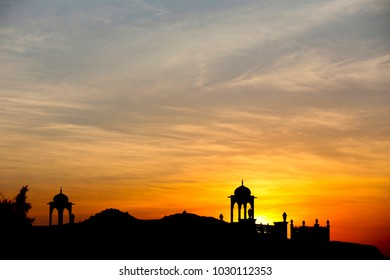 Silhouette of temple with sun