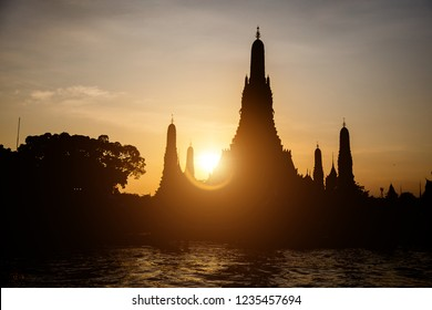 silhouette temple with sunset twiglight sky at Bangkok,Thailand. Riverside livestyle of Thai people transis with boat , Buddha temple religion.