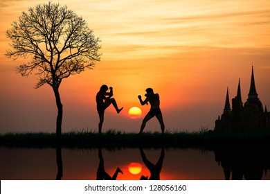 Silhouette of a thai's boxing at sunset