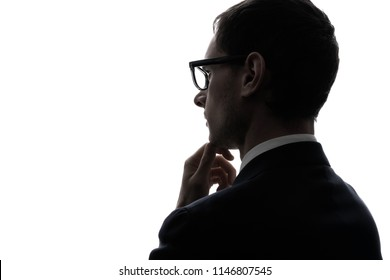 Silhouette of a thinking businessman.