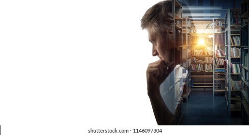Silhouette of a thinking man on the library hall background with books in bookshelf. Concept on education, science, literature, psychology, philosophy and history topics.