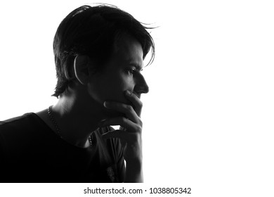 Silhouette of thinking man over white background