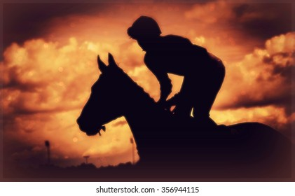 Silhouette of thoroughbred and jockey.