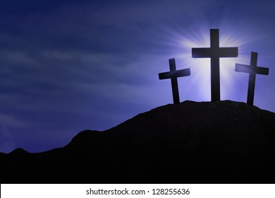Silhouette of three crosses on blue background