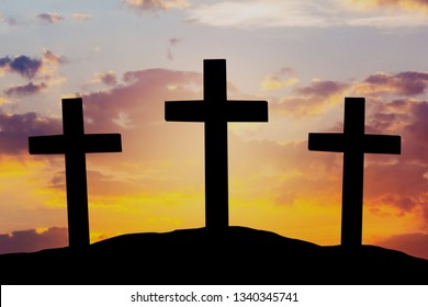 Silhouette of three crosses on evening sunset sky, Easter background