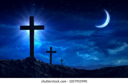 Silhouette of three crosses on a hill And night time