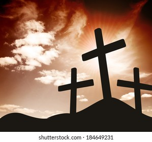 silhouette of three Crosses sign on top of a hill