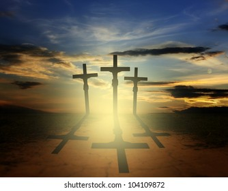 Silhouette of three easter crosses on the road