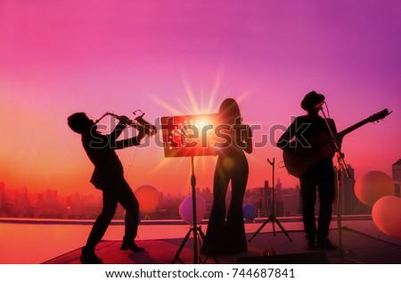 Silhouette three musician Trio