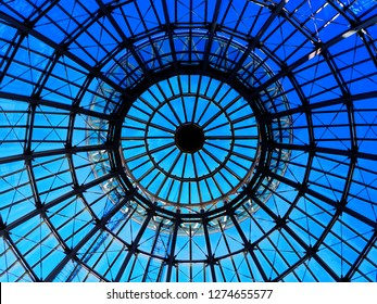 Silhouette top center circle ceiling dome roof white steel structure architecture, round dot shadow, distributed line surround, transparent clear glass wall with reflection, bright blue sky background