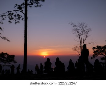 the silhouette of Tourists are waiting to see sunrise at pha Nok Aen viewpoint Phu Kradueng National Park, Loei, Thailand