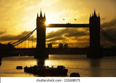 Silhouette Tower Bridge at sunrise, London, UK