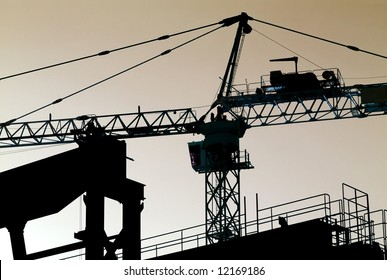 Silhouette of a tower crane at a construction site