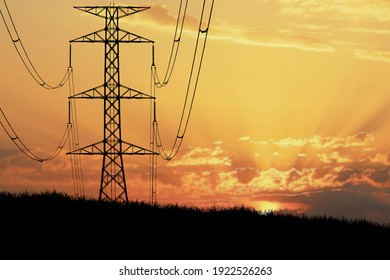 The silhouette of the tower transmits high voltage during the evening hours. Energy concept
