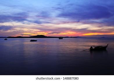 Silhouette of traditional fishing boat at dawn, Koh Lanta island, Thailand