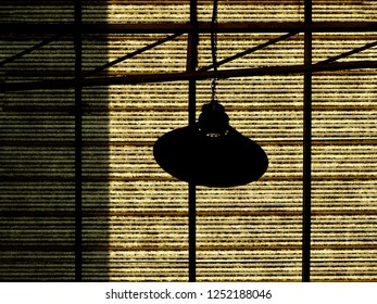 Silhouette, traditional street lamp under the roof of plaza mall. Abstrct, Old fasioned light in the shopping area without customers.