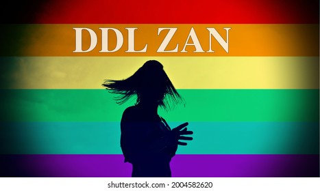 """Silhouette of a transsexual person with the pride flag as background and the text """"DDL Zan"""" new Italian law against discrimination."""