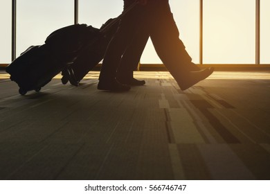Silhouette traveler with luggage walking in the airport