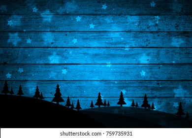 Silhouette of trees on the hill with textured wooden boards. Dark blue Christmas and New Year holiday greeting card illustration background.