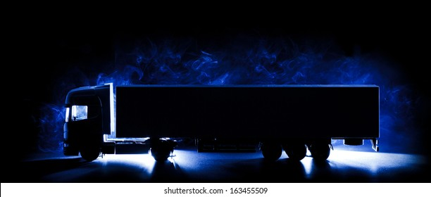Silhouette of truck with smoke