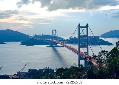 silhouette Tsing Ma double-decked suspension bridge between Ma Wan island and Tsing Yi island in Hong Kong, China at sunset