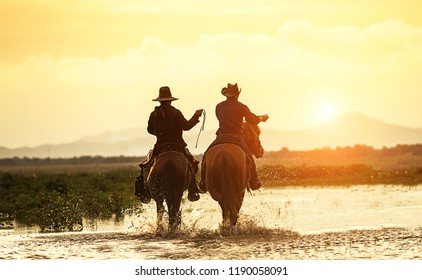 Silhouette two Cowboy on horseback. Ranch