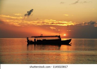 silhouette of typical boat at maldives of tropical sunset