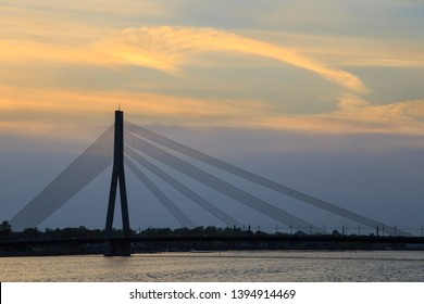Silhouette of the Vansu Bridge (Latvian: Vansu tilts), a cable-stayed bridge that crosses the Daugava river in Riga, the capital of Latvia, and passes over Kipsala island, at sunset.