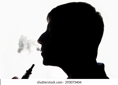 Silhouette of a vaping man with e-cigarette