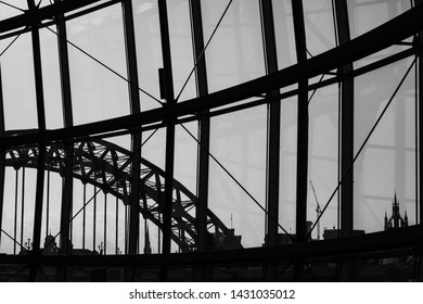 Silhouette view of Newcastle city Skyline through Sage Gateshead windows with Tyne Bridge  and other buildings at Newcastle Quayside in view
