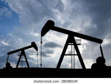 silhouette view of Oil pumps and sunset. Oil industry equipment.