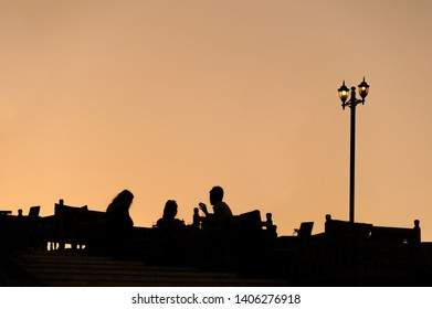 A silhouette view of unidentfied people having drinks rinks on the terrace at dusk in Sanliurfa, Turkey.