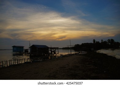 Silhouette of village at Catatumbo River near the Maracaibo Lake during a beautiful sunset in Venezuela