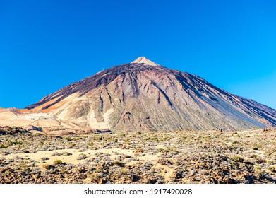Silhouette of volcano del Teide against  blue sky. Pico del Teide mountain in El Teide National park. Tenerife, Canary Islands, Spain