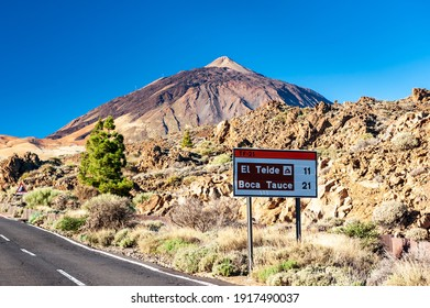 Silhouette of volcano del Teide and signpost against  blue sky. Pico del Teide mountain in El Teide National park. Tenerife, Canary Islands, Spain