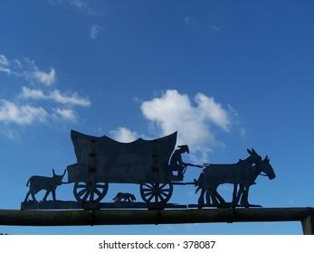 silhouette of wagon train