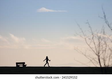 Silhouette of walker on horizon
