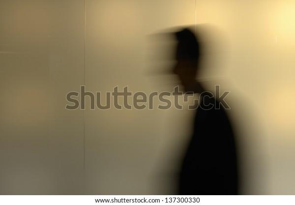 Silhouette of a walking man, motion blur