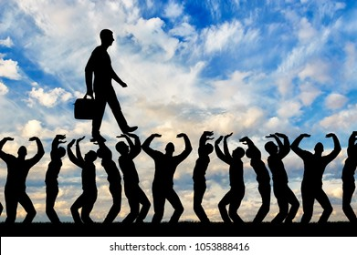 Silhouette of a walking selfish and narcissistic man on the hands of the crowd. The concept of selfishness and narcissistic personality