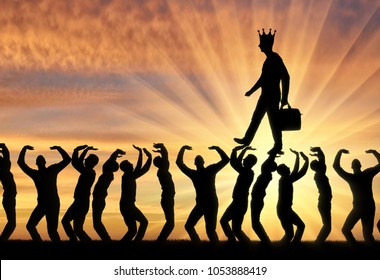 Silhouette of a walking selfish and narcissistic man with a crown on his head on the hands of the crowd. The concept of selfishness and narcissistic personality