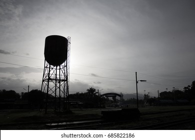 Silhouette water tank in the small town.